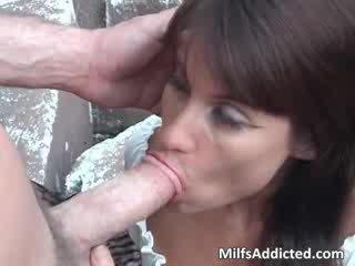 Sexy brunette MILF sucks big cock