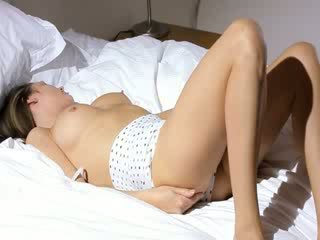 Busty schoolgirl wow stripping on a bed