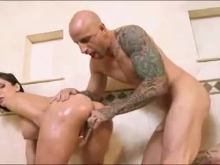 Busty brunette pornstar Aleksa Nicole oils up her ass in the shower