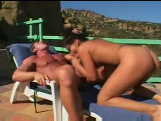 Brunette gives blowjob and enjoys a facial