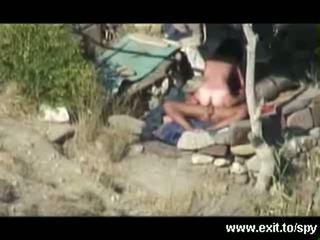 Salvaje playa sexo pillada en espía camera
