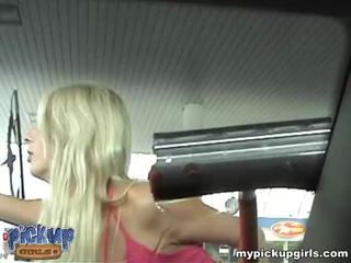 An attractive blonde on the car wash practices sex for money. Video