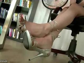 Hot secretary showing off her nice feet