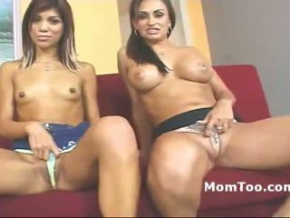 Busty MILF and young daughter fingering