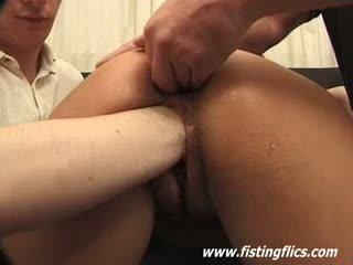 Kinky slut gets a brutal gang bang fisting