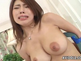 Petite Japanese babe servicing two cocks