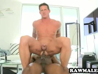 Ebony hunk fucks a muscular stud