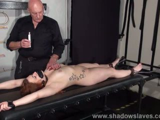 Amateur slave Louise in dungeon rack bondage