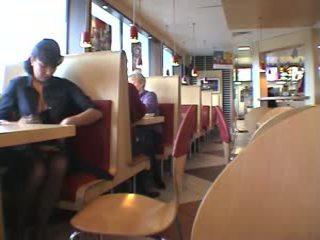 Brunette babe gets naked inside of a McDonalds