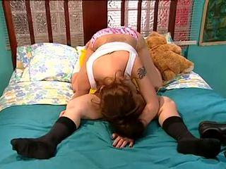 Teen Sabrina Jade...plays with a big doll