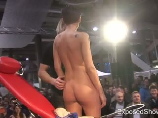 Hot slut playing with a rock hard cock at the sex show Video