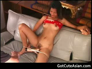 Thai doll putting a big vibrator in her