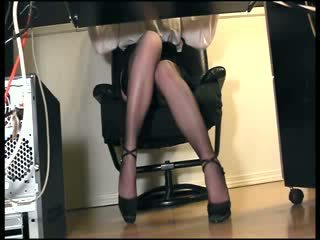 Secretary masturbating in stockings under desk hidden voyeur view