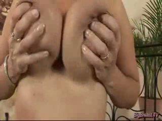 Breasty dame masturbating