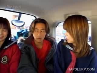 Adorable doll oriental girls having fun in the car