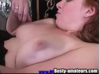 Busty Ginger toying and fingering her pussy