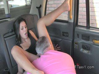 Brunette gives voetjob in fake taxi