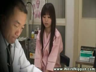 Introvert asian in doctors office for breast check up