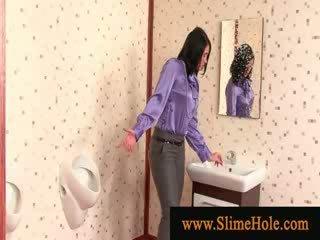 Slime showered brunette sucking gloryhole cock