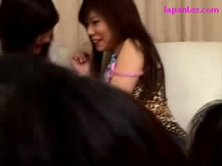 4 asian girls Kissing In Pairs Sucking Tongues On The Couch At The House Party
