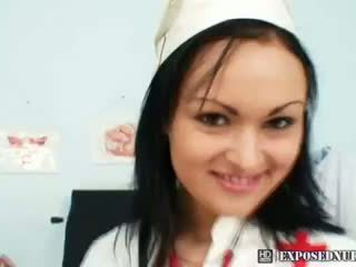 Horny nurse Pavlina is dildoing herself on gynochairnurse uniform pussy gap