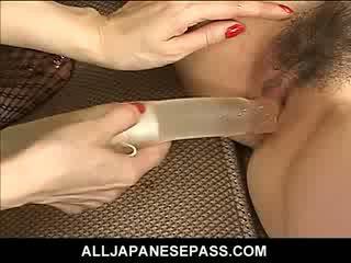 Horny mature Japanese AV model teaches a hot babe Asian cheerleader the facts of life