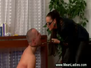 Domina smoking while spanking servant