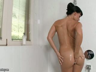 Aletta Ocean spray her body with water from shower hose