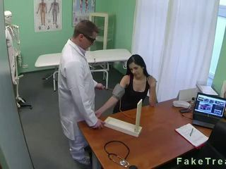 Dark haired babe fucked in fake hospital