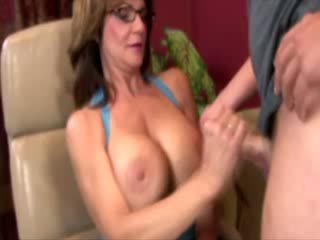 Sweet sexy MILF is giving a handjob