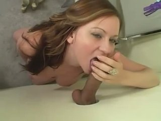 Violet Addamson fucks a rampant rod through a hole in a changing room wall