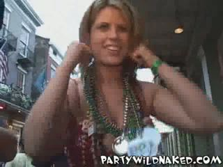 Wild Mardi Gras Girls with Body Painted Breasts