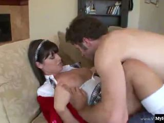 Sexy brunette, Sadie West, dressed in a schoolgirl uniform, gets it on with