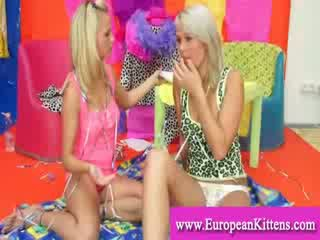 Blondes getting dirty with whipped cream