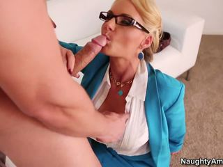 Hot and sexy lady in glasses seduces younger man.