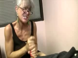 She gets both hands around his dick to make him cum