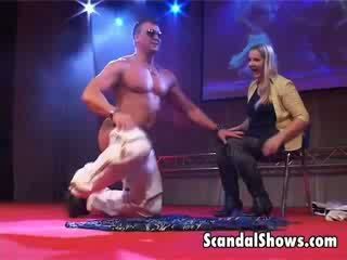 Handsome male striper invites sexy girl on stage and gives her hot lap dance