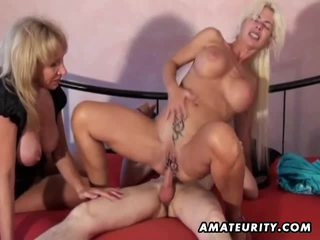 Amateur homemade threesome with 2 milfs and a young guy