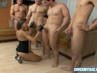 Cutie giving head to 4 big cock guys