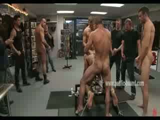 Lucky gay bastard thrown on his knees doggystyle and bound in ropes on a fuck table and penetrated