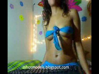 Sexy latina schoolgirl dancing in room