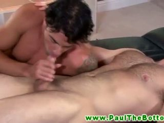 Muscle bottom in trio sucking on thick dick