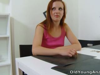 Sveta is waiting at her table reading a magazine and waiting for her older man to arrive at her place