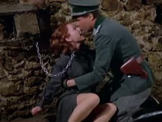 Nathalie whipped by evil Nazi woman