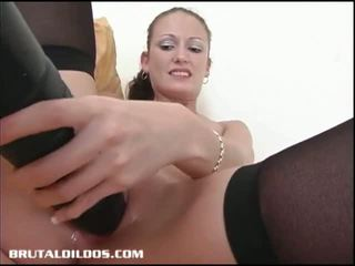 Petite Hailey Young Stretches Her Pussy with Huge Dildo