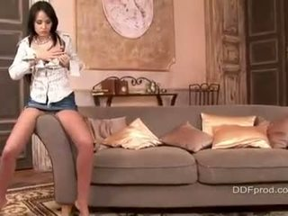 Pretty Angel Kiss sexily stripping her clothes and gets hot on a sofa