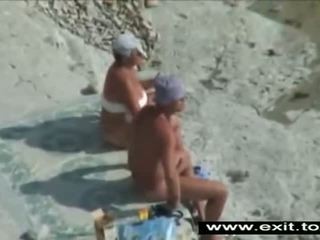 Spying on mature Couples on the beach