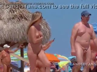 Milf mom on Haulover beach in Miami fully naked in public showing smooth shaved pussy!