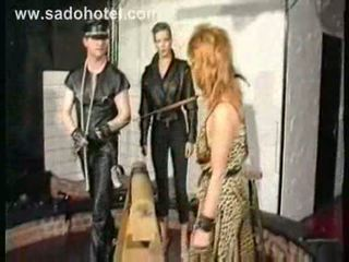 Several slaves in a dungeon got tied spanked and metal clamp