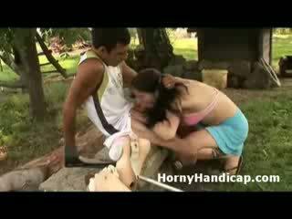 Horny handicap gets sucked and fucks a horny babe outdoors